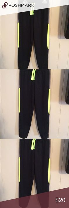 NWT boys Jumping Bean Pants NWT Boys Jumping Bean Pants lightly fleece lined black with green stripes on side. Pockets, fitted at bottom with elastic waist. Jumping Bean Bottoms Casual