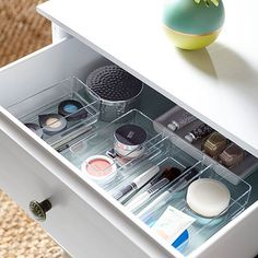 Stack acrylic containers (cheap at Home Goods/Marshall's/TJ Maxx) in drawers for maximum storage and small item management