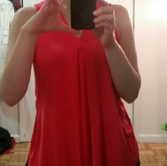 Like New Deep Coral Top Bright & fun, this top is SO airy, soft and comfy.  I like it with white jeans or shorts. Each side has slits and the material has stretch.  Only worn twice. Perfect condition Tops Tank Tops