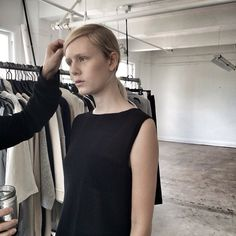 Brochu Walker Pre-FALL 2015 photoshoot, behind the scenes in a simple black dress.