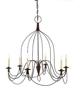"""Crafted in the style of 18th-century wire lamps from France, chandelier features a graceful hand-curved shape, wire-wrapped joints and an antiqued rust finish.  • 36"""" diam., 40""""H;"""