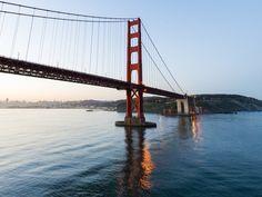 San Francisco San Francisco, California sky outdoor water bridge building cable stayed bridge River Sea traveling reflection nonbuilding structure suspension bridge pier long day