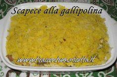 Filetti di alici fritti e fatti marinare tra strati di mollica di pane imbevuta con aceto e zafferano