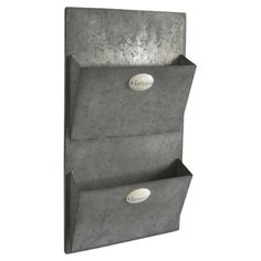 Distressed metal wall-mount mail holder with label accents.  Product: Wall mount mail holderConstruction Material: