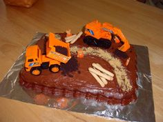 I used chocolate frosting on a 9x13 cake, construction trucks, crushed OREOS for dirt, Teddy Graham workers decorated with orange royal frosting, and cracker sticks for logs.