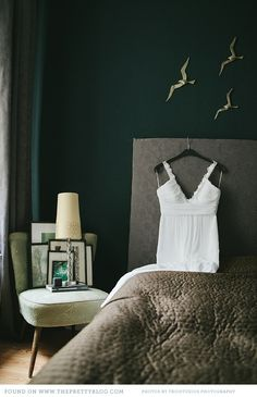 love the dark green wall and gray combo