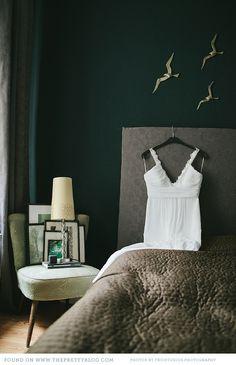 love the dark green wall and gray combo