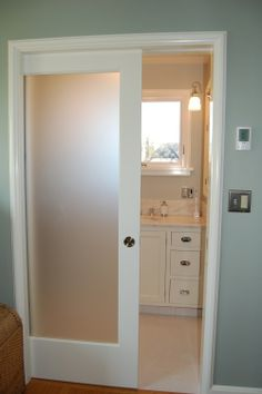 I love frosted glass, for showers, for water closets, for doors interior and exterior. Heres a pocket door with frosted glass for a master bathroom, part of a renovation project bringing a 1928 house back to historical integrity while adding contemporary features. Not my cup of tea, but it is lovely.