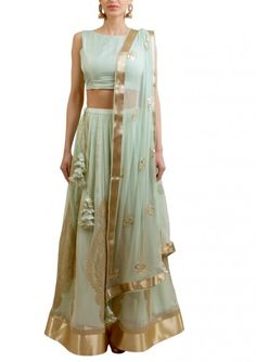 Mint georgette lehnga with paisely motif and silk knotted choli.