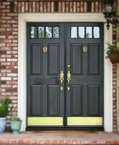 Black front door with Brass Lion door knockers, door harware and brass kick plates {a front door makeover }