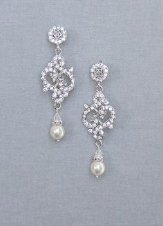 Vintage inspired bridal pearl drop earrings featuring Swarovski crystal accented with Miyuki pearl and crystal drop.  Rhodium plated motif Lead and nickel