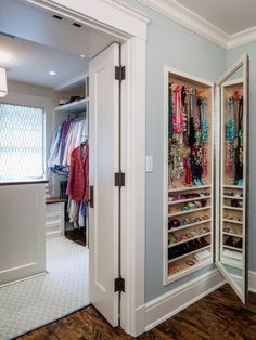 This jewelry storage is built into the wall to save space!  Would you want something like this in your home?