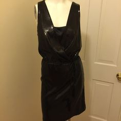 NWOT all sequined little black dress by WHBM,  10 Brand-new never worn all sequined little black dress by White House Black Market.  Crisscross front neckline, with built-in camisole lining.  Elasticized waist with braided tie belt with hanging tassels.  Fully lined straight skirt.  Great little black dress that makes you stand out with sparkle!!!  Size 10 White House Black Market Dresses