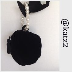 """Evening Bag - Bracelet or Ring Style Vintage 1960's small, round, black velvet evening bag with pearled bracelet handle and tassel embellished zipper closure. Perfect for an elegant evening. The lovely bag stays nicely on your wrist. Approx. 5"""" tall x 3""""wide *** Note: picture 2 shows a scratch on one of the pearl-like beads. It is not noticeable when worn.  🚫 Trades 🚫 Holds Bags"""