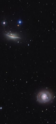 At the top, large spiral galaxy NGC 1055, and the bottom spiral Messier 77, in this sharp cosmic view toward the aquatic constellation Cetus. The narrowed, dusty appearance of edge-on spiral NGC 1055 contrasts nicely with the face-on view of M77's bright nucleus and spiral arms. Both over 100,000 light-years across, the pair are dominant members of a small galaxy group about 60 million light-years away. M77 and NGC 1055 are separated by at least 500,000 light-years.