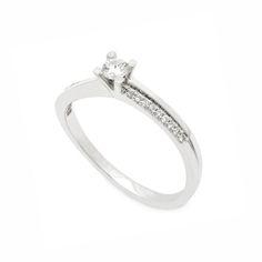 Μονόπετρο δαχτυλίδι με Brilliants λευκόχρυσο Κ18 με καμπύλο σκελετό προς το  κεντρικό διαμάντι και σειρέ από 1caddcc691c