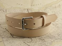 The Cyril Belt with Silver Roller Buckle. Cut, punched and burnished edges all done one belt at a time with sore hands and old tools. Free Personalization if you so please! #Cyril #madetowander #madebyhand #handmade #cyrilleatherandsuch #leather #wander #sorehandsoldtools