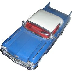 Model of the 1957 Cadilac Elderado Seville. Excellent mounted on a removable base! found at www.rubylane.com @rubylanecom