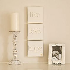 Very easy! Take blank canvas' and glue wooden letters on, and then paint all one color!! AWESOME idea and very sleek looking!!
