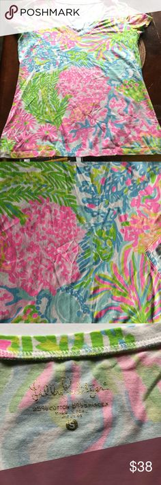 SALE! LILLY Pulitzer Lovers Coral Michele V-Neck Lilly Pulitzer T-shirt in excellent condition!  Washed once and wrapped up. No stain, tears, rips or holes. Nice bright colors. I love Lilly Pulitzer, but I wore once and didn't like how bright it was on me. Style number:70082. 95% cotton, 5% spandex. Color: Multi More Lovers Coral. ❤️💚💗I will mark down for you to possibly get reduced shipping.❤️💚💗 Lilly Pulitzer Tops Tees - Short Sleeve