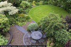 Round lawn as part of a circular themed garden.