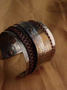 Cuff | Mirek Gomolka. Stainless steel and copper.