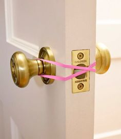 "Loop a single rubber band around a door's inside and outside knobs, twisting it as you do so that the ""X"" presses the latch open."