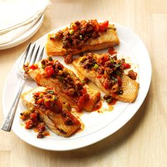 Grilled Salmon with Chorizo-Olive Sauce Recipe -Every one of the ingredients in this recipe brings a ton of flavor. Both chorizo and salmon cook in a hurry, and garlic and citrus go beautifully with them, too. —Charlene Chambers, Ormond Beach, Florida