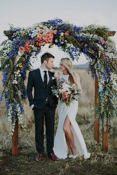 Him and her, wedding day photography. Stunning hand-made floral alter.