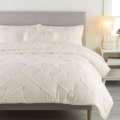 Our Ashlyn Tufted Comforter and Sham bring warm, casual charm to your sleep space. It's woven from sustainably sourced pure cotton crinkle fabric handcrafted with a tufted pattern that adds texture and interest. BCI and STANDARD 100 by OEKO-TEX(R) certified, you can rest assured knowing it's free of hundreds of harmful substances and is made from responsibly produced cotton. STANDARD 100 by OEKO-TEX(R) certified - tested against a list of over 350 harmful substances. BCI (Better Cotton…