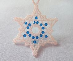 Browse unique items from LescreationsAlepine on Etsy, a global marketplace of handmade, vintage and creative goods. Snowflake Wreath, Crystal Snowflakes, Christmas Decorations, Christmas Ornaments, Beaded Ornaments, Wooden Beads, Bead Weaving, Bead Crafts, Crochet Earrings