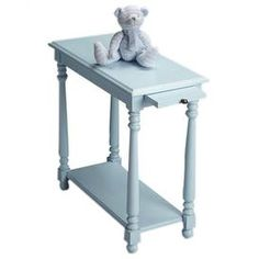 """End table with a pull-out shelf.Product: End table    Construction Material: Select wood solids and wood products    Color: Baby blue   Features:  Lower display shelf for books or other objects    Pull out shelf suitable for placing a beverage    Ideal blend of function and design   Dimensions: 24.25"""" H x 12"""" W x 24"""" D"""