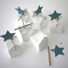 Gift box houses with sticks and stars