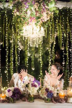 Suspended floral arrangements and fairy lights wedding decor // Plush Phuket Wedding Which Ended in an Explosion of Fireworks: Aston and Victoria