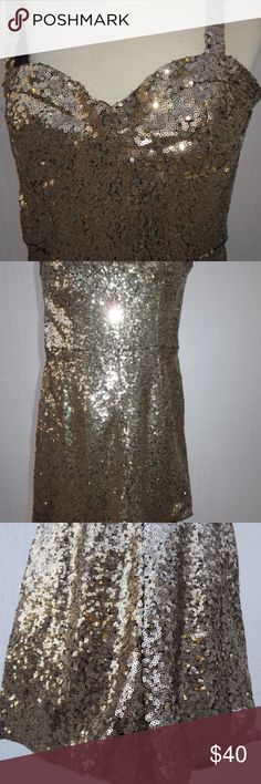 Wyldr Gold Sequin Mini Romper Jumpsuit Wyldr Gold Sequin Mini Romper Jumpsuit Attention grabbing outfit! Nearly new!  Excellent used condition (EUC).  Pre-owned & worn.  Gold sequin mini romper/jumpsuit with narrow straps; zippered back.  Heart shaped bodice.  Narrow straps. Wyldr Other