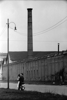 Industrial building in a romantic setting   (Photo by Mario de Biaisi : 'Love in the suburbs', Milan 1952)