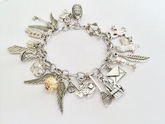 Harry Potter Charm Bracelet, Golden Snitch Bracelet by Trinketberry on Etsy https://www.etsy.com/listing/464038057/harry-potter-charm-bracelet-golden