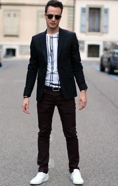 Something as simple as teaming a black blazer with burgundy slim jeans can potentially set you apart from the crowd. White low top sneakers will give your look an on-trend feel. Shop this look for $104: http://lookastic.com/men/looks/sunglasses-and-crew-neck-t-shirt-and-blazer-and-belt-and-skinny-jeans-and-low-top-sneakers/3305 — Black Sunglasses — White and Black Vertical Striped Crew-neck T-shirt — Black Blazer — Black Leather Belt — Burgundy Skinny Jeans — White Low Top Sneakers