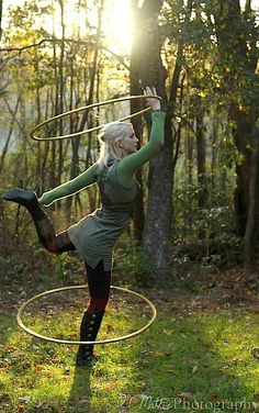 An actual photo of me doing my thing!!  Christina Berkshire | Hooping.org