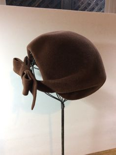 A personal favorite from my Etsy shop https://www.etsy.com/listing/264410241/vintage-cocoa-brown-felt-mini-hat-b
