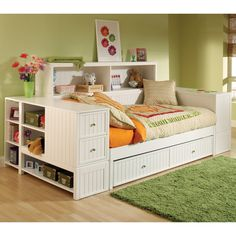 If space is at a premium, make your child's bed equally appealing for hanging out and sleeping. The Cody Daybed ($2,229) has it all: comfort, style, and tons of storage. The bottom drawer can be used for a trundle bed or storage, the sides of the daybed are stacked with shelves and drawers, and there's a bookcase sideboard for even more storage.