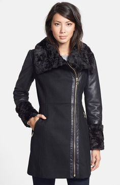 Free shipping and returns on GUESS Faux Shearling Contrast Wool Blend Coat (Online Only) at Nordstrom.com. Two top trends—moto styling and luxe trim—meet in one good-looking coat. The fitted silhouette is shaped from a refined wool blend and framed with textured faux-shearling sleeves. Plush faux fur at the wing collar and cuffs, along with gleaming goldtone hardware, complete the flattering design.