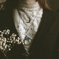"""Izzy draped a necklace around my neck, patting it down into my blouse with her pale hand. """"This is the enchanted necklace of the Moon."""" she explained, moving her hands to my hair. """"What does it do?"""" I asked breathlessly, running my hands down her sides and resting them at her hips. """"It keeps you safe."""" she told me, looking deep into my eyes, """"For when I'm not around."""" """"You'll always be around."""" I said softly, """"You're my Gatekeeper."""""""