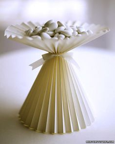 Construct a compote from a single piece of paper folded accordion-style, and fill with sugar-coated almonds