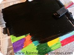 Paint over entire oil pastel colored paper with black acrylic paint.   Harrington Harmonies