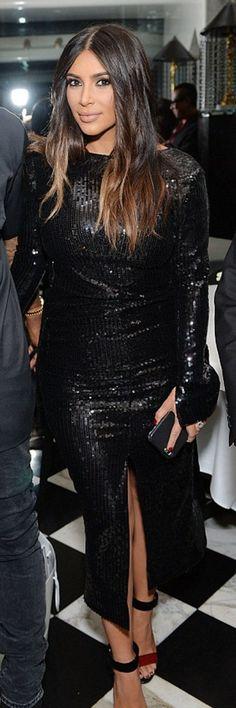 Who made  Kim Kardashian's black sequin long sleeve dress and sandals?