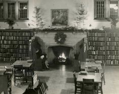 A cosy, warm picture for a cold, blustery week: Toronto Public Library staff member Marjorie Bullard reads in the Children's section, ensconced in the inglenook of the High Park library's fireplace. This photograph was taken by her brother, Maurice, at Christmastime in 1940. Marjorie worked in several branches in her 45 years of service, and retired from the Locke branch in 1973.