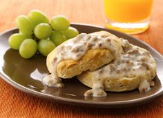 Biscuits: 1 (16.3-oz.) can Pillsbury® Grands!® Refrigerated Buttermilk Biscuits. Gravy: 12 oz. bulk pork sausage, 1/3 c. all-purpose flour  1/2 tea. salt, 1/4 tea. coarse ground black pepper, 3 c. milk. Directions: Heat oven to 350°F. Bake biscuits as directed on can. Crumble sausage into large skillet. Cook over medium-high heat until browned stirring frequently. With wire whisk, stir in flour, salt and pepper. Gradually stir in milk. Cook until mix thickens. Serve over biscuits