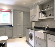 An inspiring and stylish showcase of built in storage solutions for the laundry #laundry