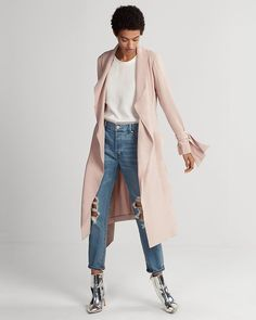Light draping fabric puts a soft, elegant spin on the classic trench coat silhouette. A sash tie waist maintains an air of timeless charm, so prepare to bring this one out season after season.